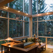 An interior view of the living area feautirng architecture, daylighting, deck, home, house, interior design, living room, outdoor structure, patio, table, window, wood, brown, black