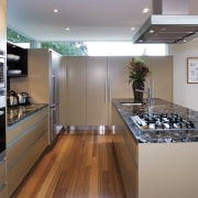 A view of this kitchen featuring polished timber countertop, interior design, kitchen, room, gray