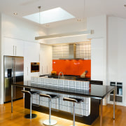 A view of this kitchen featuring kauri flooring, ceiling, furniture, interior design, kitchen, room, table, gray, white