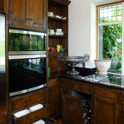 A view of this kitchen feautring solida aged cabinetry, countertop, furniture, interior design, kitchen, room, window, brown
