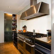 A veiw of this kitchen featuring stainless steel cabinetry, countertop, cuisine classique, home appliance, interior design, kitchen, room, gray, brown