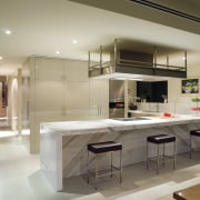 A view of this kitchen featuring clalcutta marble cabinetry, countertop, cuisine classique, interior design, kitchen, gray