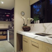 A view of this kitchen featuring clalcutta marble countertop, interior design, kitchen, room, gray, black