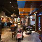 Like much of the interior, the hand-painted concrete café, interior design, restaurant, black, brown