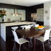 This contemporary kitchen incorporates plenty of storage, including countertop, dining room, interior design, kitchen, real estate, room, table, black, gray