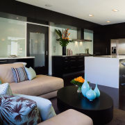 The sliding door leads to the hallway and home, interior design, living room, real estate, room, suite, gray, black