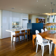 Between kitchen and dining room, the colour scheme dining room, flooring, interior design, kitchen, real estate, room, table, gray, brown