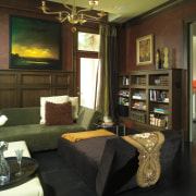 Subtly patterend wallpaper features above the libary's mahogany interior design, living room, real estate, room, brown