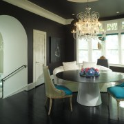 Graphite-coloured walls in the dining room are a ceiling, chair, dining room, furniture, home, interior design, living room, real estate, room, table, window, black