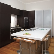 A view of the modern Smeg stainless steel furniture, interior design, kitchen, room, gray, black