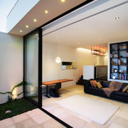 The floor level of the living area was ceiling, house, interior design, living room, lobby, real estate, gray