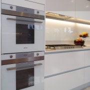 A view of this kitchen featuring the latest cabinetry, countertop, home appliance, interior design, kitchen, kitchen appliance, kitchen stove, major appliance, product design, gray