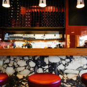 Shades of red add warmth, while chrome and furniture, interior design, lighting, restaurant, table, black, gray