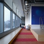 Along, slender reading area forms part of DDB's architecture, floor, flooring, interior design, office, product design, gray