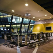 Back-dropped by a feature panel in DDB's coroprate architecture, auditorium, ceiling, conference hall, interior design, lobby, black, brown