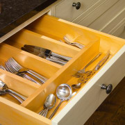 A view of this traditional kitchen featuring antique drawer, furniture, product design, table, wood, yellow, brown, orange