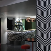 The entrance of the Hunter Bar incorporates three architecture, ceiling, design, glass, interior design, light fixture, wall, wallpaper, black, gray