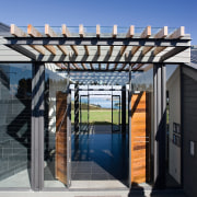 The entrance brings patrons downstairs into a foyer architecture, facade, house, outdoor structure, pergola, real estate, residential area, roof, structure, gray, blue, black