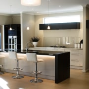 Contrasting cabinetry brings a touch of warmth to countertop, floor, flooring, furniture, interior design, kitchen, lighting, product design, gray