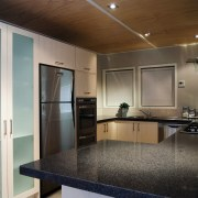 A view of this kitchen featuring the new countertop, interior design, kitchen, real estate, room, black, gray