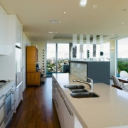 Raised cabinetry intergrated into the back of the countertop, house, interior design, kitchen, real estate, gray