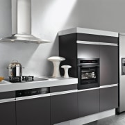 A view of this kitchen featuring the latest countertop, cuisine classique, home appliance, kitchen, kitchen appliance, kitchen stove, major appliance, oven, product, product design, refrigerator, small appliance, gray, black