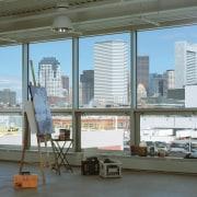 Traslucent acrylic panels ensure natrual daylight penetrates throughtout building, metropolitan area, window, gray