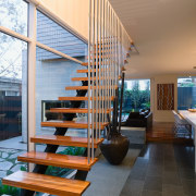 Stainless steel balustrading extends the full height of architecture, condominium, daylighting, handrail, house, interior design, living room, real estate, stairs