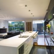 The reconstituted stone benchtop doubles as a dining ceiling, countertop, estate, house, interior design, living room, property, real estate, gray