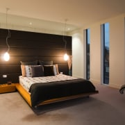 The master ensuite features a freestanding waal, which bed, bed frame, bedroom, ceiling, floor, furniture, interior design, room, wall, black, orange