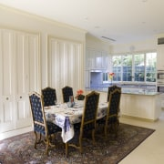 The dining room and kitchen open onto a dining room, home, interior design, property, real estate, room, window, gray