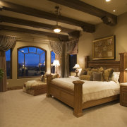 A view of the master bedroom with a bed, bedroom, ceiling, estate, furniture, home, interior design, lighting, room, suite, brown