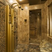 A view of this bathroom featuring gold wave bathroom, ceiling, floor, flooring, interior design, lighting, lobby, room, wall, brown
