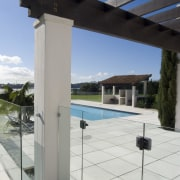 A view of this outdoor pool area featuring daylighting, glass, property, structure, window, gray, white