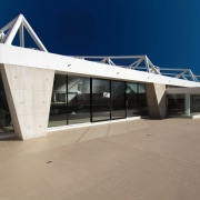 An exterior view of the ian thorpe aqautic architecture, building, roof, structure, gray, blue