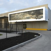 Cantilevered administrative offices transform the front facade of architecture, building, facade, house, gray