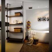 A view of the master bedroom. - A ceiling, furniture, home, interior design, room, shelf, shelving, gray, black