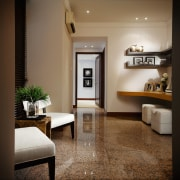 A view of the entrance way, granite flooring, floor, flooring, furniture, home, interior design, living room, room, table, black, brown