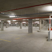 A view of the interior and exterior tiling, metropolitan area, parking, parking lot, public space, gray