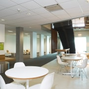 An interior view of the office building  architecture, ceiling, interior design, office, real estate, table, gray