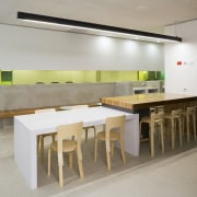 An interior view of the office building  furniture, interior design, product design, table, gray