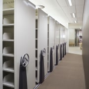 An interior view of the office building  furniture, interior design, shelving, gray