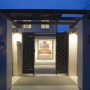 This masonry home, with interior design and colour architecture, door, lighting, blue
