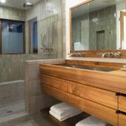 A view of a bathroom. - A view bathroom, floor, flooring, interior design, room, gray, brown