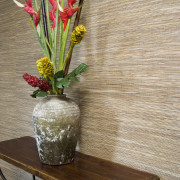 A view of some wallpaper from Vision Wallcoverings. cut flowers, flora, floral design, floristry, flower, flower arranging, flower bouquet, flowerpot, ikebana, plant, table, vase, brown, orange