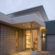 A fully glazed front door, exposed honedblock and architecture, building, daylighting, elevation, facade, home, house, real estate, residential area, roof, siding, window, teal