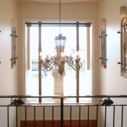 A view of a home designed by MF baluster, door, glass, handrail, home, interior design, iron, light fixture, wall, window, brown