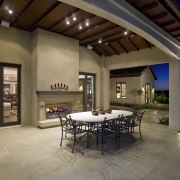 The outdoor furniture and accessories complement the extensive estate, interior design, living room, patio, property, real estate, brown
