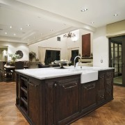 All in-built furniture was custom designed by Masonry cabinetry, ceiling, countertop, cuisine classique, floor, flooring, hardwood, interior design, kitchen, room, wood flooring, gray, brown