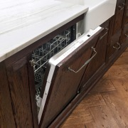 A view of some kitchen appliances from De'Longhi. cabinetry, countertop, drawer, floor, flooring, furniture, hardwood, sink, wood, wood stain, brown, white